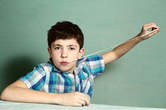 Boy pull chewing gum with his hand from moth Royalty Free Stock Photography