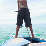 A boy pulling anchor boat Royalty Free Stock Photo