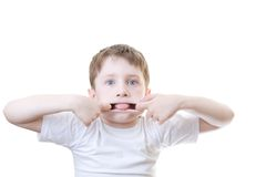 Boy pulling funny face Royalty Free Stock Photography