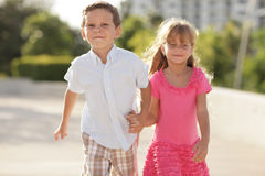 Boy pulling the girl Stock Image