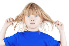 Boy pulling his hair Stock Photography