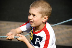Boy pulling rope Stock Photos