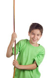 Boy pulling a rope. Isolated on white stock image