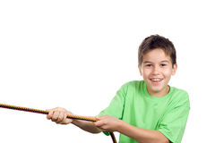 Boy pulling a rope. Isolated on white stock images