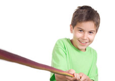Boy pulling a rope. Isolated on white royalty free stock photos