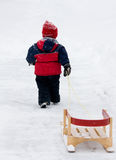 Boy pulling sled Royalty Free Stock Photography