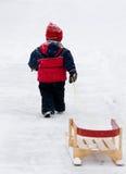 Boy pulling sled Royalty Free Stock Photography