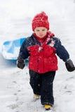 Boy pulling sled royalty free stock image
