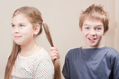 Boy pulls the girl's hair Stock Photos