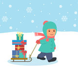The boy pulls a sled with gifts Stock Image