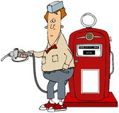 Boy pumping gas from a retro pump Royalty Free Stock Photos