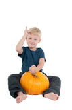 Boy with a pumpkin Stock Photography