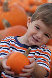 Boy and pumpkin Royalty Free Stock Photos
