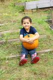 Boy and a pumpkin Royalty Free Stock Photos