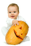 Boy with pumpkin. Cute little smiling boy with halloween pumpkin on white background Royalty Free Stock Images