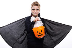 Boy with pumpkin basket dressed like vampire for Halloween party Royalty Free Stock Photos
