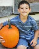 Boy with Pumpkin Stock Photos