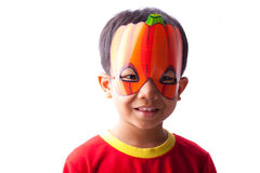 Boy with pumpkin mask. An Asian boy with a Halloween pumpkin mask Royalty Free Stock Photography