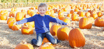 Boy at pumpkin patch Royalty Free Stock Images