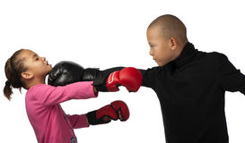 Boy punches girl. Stock Images