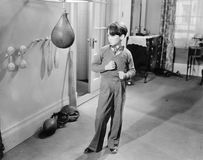 Boy with punching ball in the living room. (All persons depicted are no longer living and no estate exists. Supplier grants that there will be no model release Stock Photo