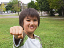 Boy punching with fist Stock Photos