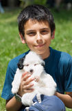 Boy and puppy. A boy and a little puppy Royalty Free Stock Image
