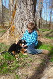 Boy and puppy Royalty Free Stock Images