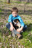 Boy and puppy Stock Photography