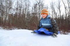 Boy by push off  intend drive from hill in winter Stock Image