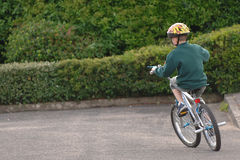 A boy on pushbike. A Youth on push bike royalty free stock photo
