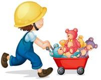 Boy pushing cart full of teddy bears Stock Photo