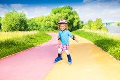 Boy pushing roller-skating Stock Photography