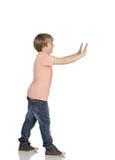 Boy pushing something Stock Photos