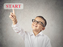Boy pushing start button Royalty Free Stock Photography