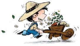 Boy pushing a wheelbarrow Royalty Free Stock Photos