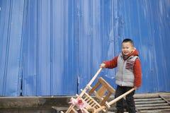 Boy pushing wheelbarrow Royalty Free Stock Photo