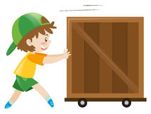 Boy pushing wooden box alone Stock Images