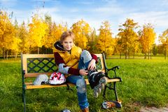 Boy put on rollerblade Royalty Free Stock Images