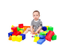 Boy puts cubes and pyramid Stock Image