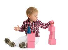 Boy puts pyramid Stock Image