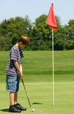 Boy Putting