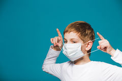 Boy putting on protection mask Royalty Free Stock Photo