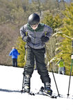 Boy Putting on Skis Royalty Free Stock Photography