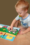 Boy and Puzzle Stock Photo