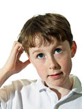 Boy with puzzled look Stock Image