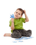 Boy with puzzles Stock Photo