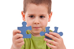Boy with puzzles Stock Photography