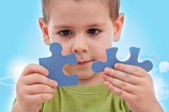 Boy with puzzles Royalty Free Stock Photography