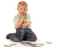 Boy with puzzles. Thinking... Stock Images